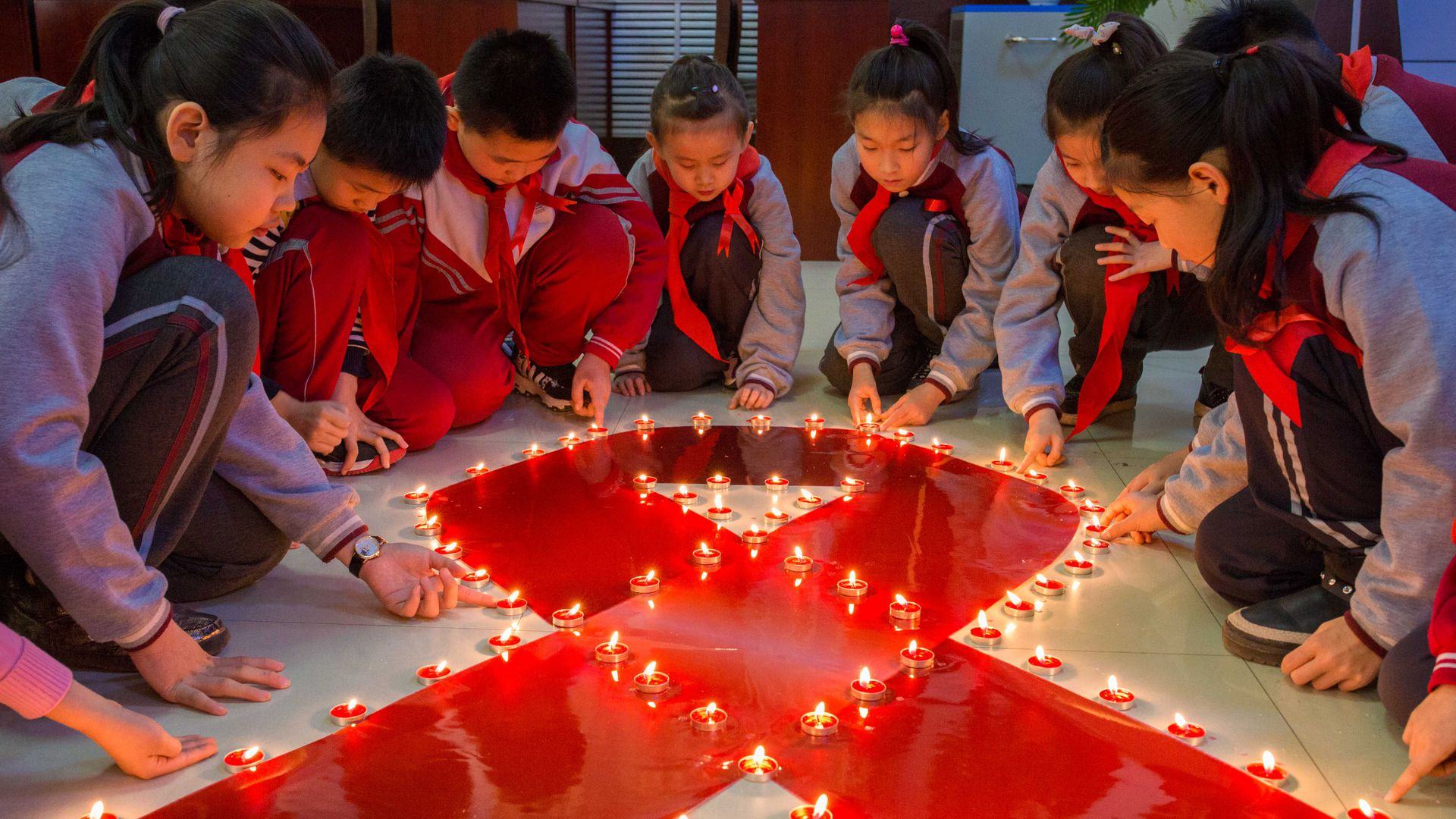 Chinese students lighting candles