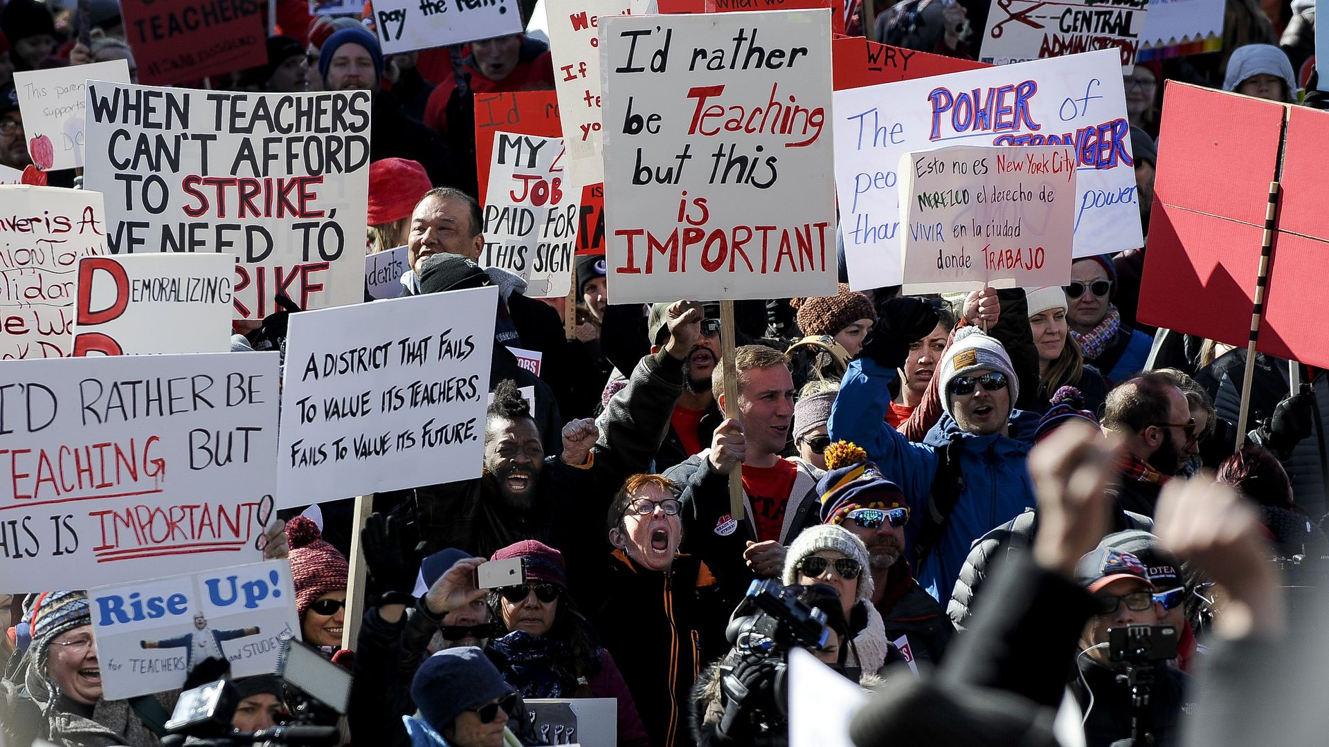 Denver teachers and supporters rally at the Colorado State Capitol on Monday.
