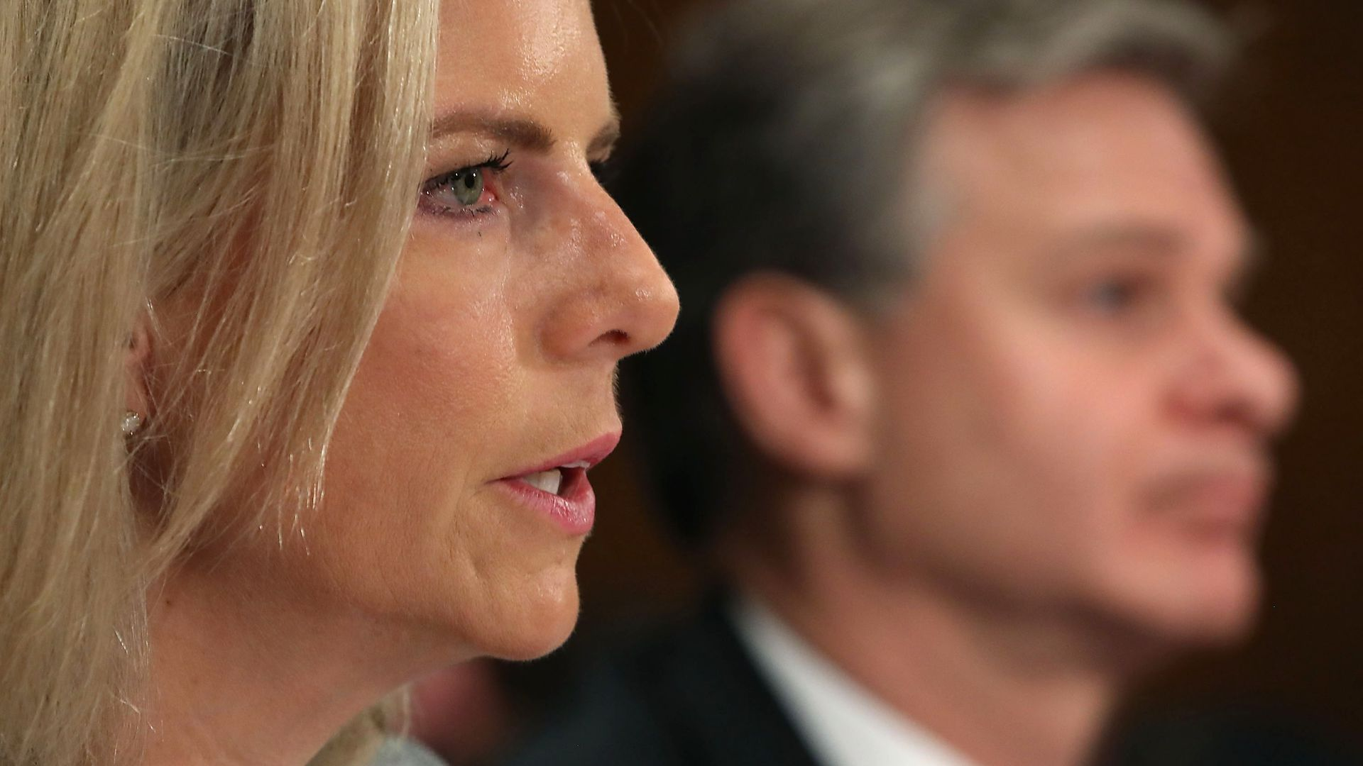 A close up of the profile of DHS Secretary Kirstjen Nielsen testifying for Congress.