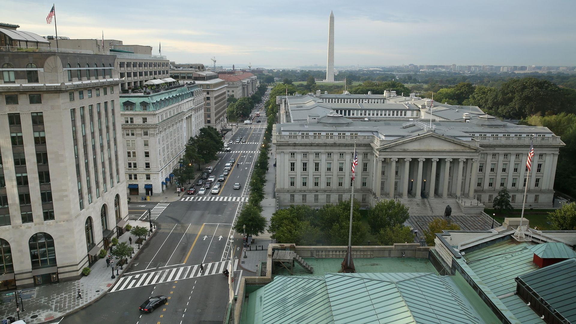 This image is a birds-eye view of the Treasury Building and the street next to it in DC. The Washington monument is seen in the distance.