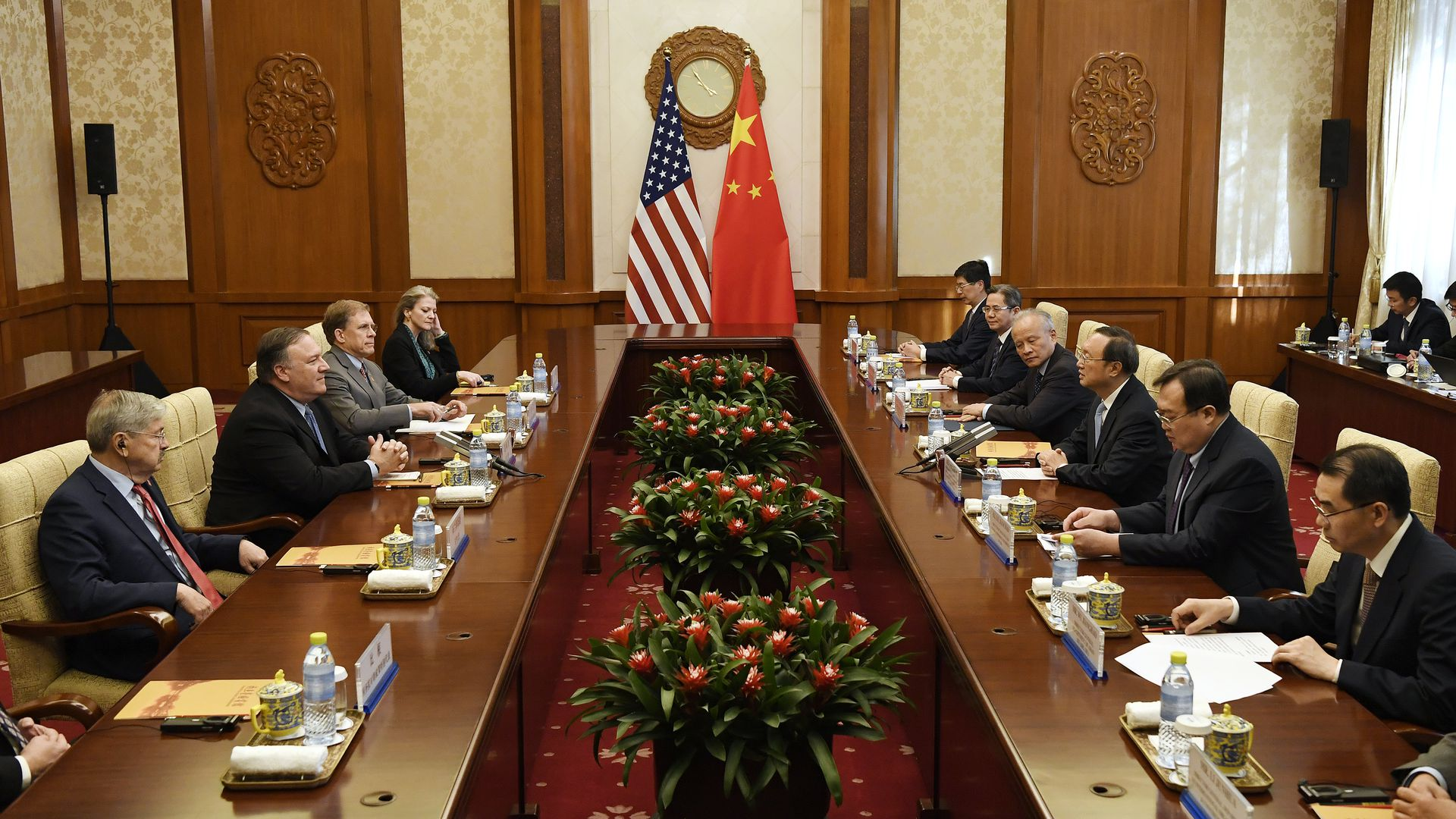 U.S. and Chinese delegations sit across from one another.