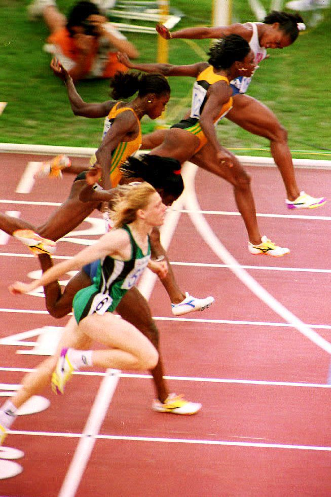 Gail Devers crossing the finish line