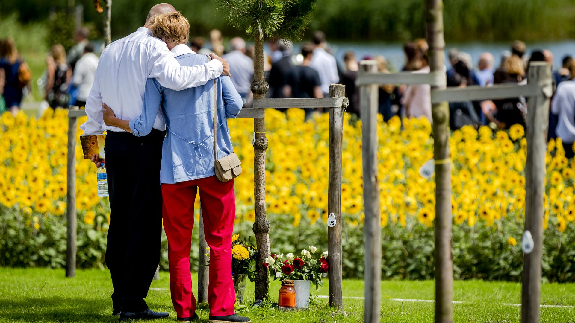 Relatives of MH17 victims mourn at the memorial site