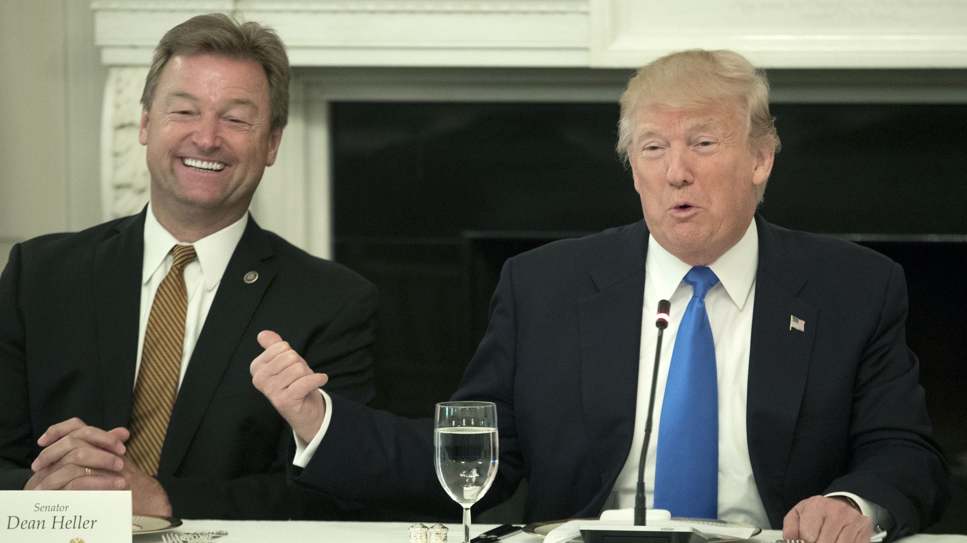 Sen. Dean Heller and President Trump sitting at a table next to each other