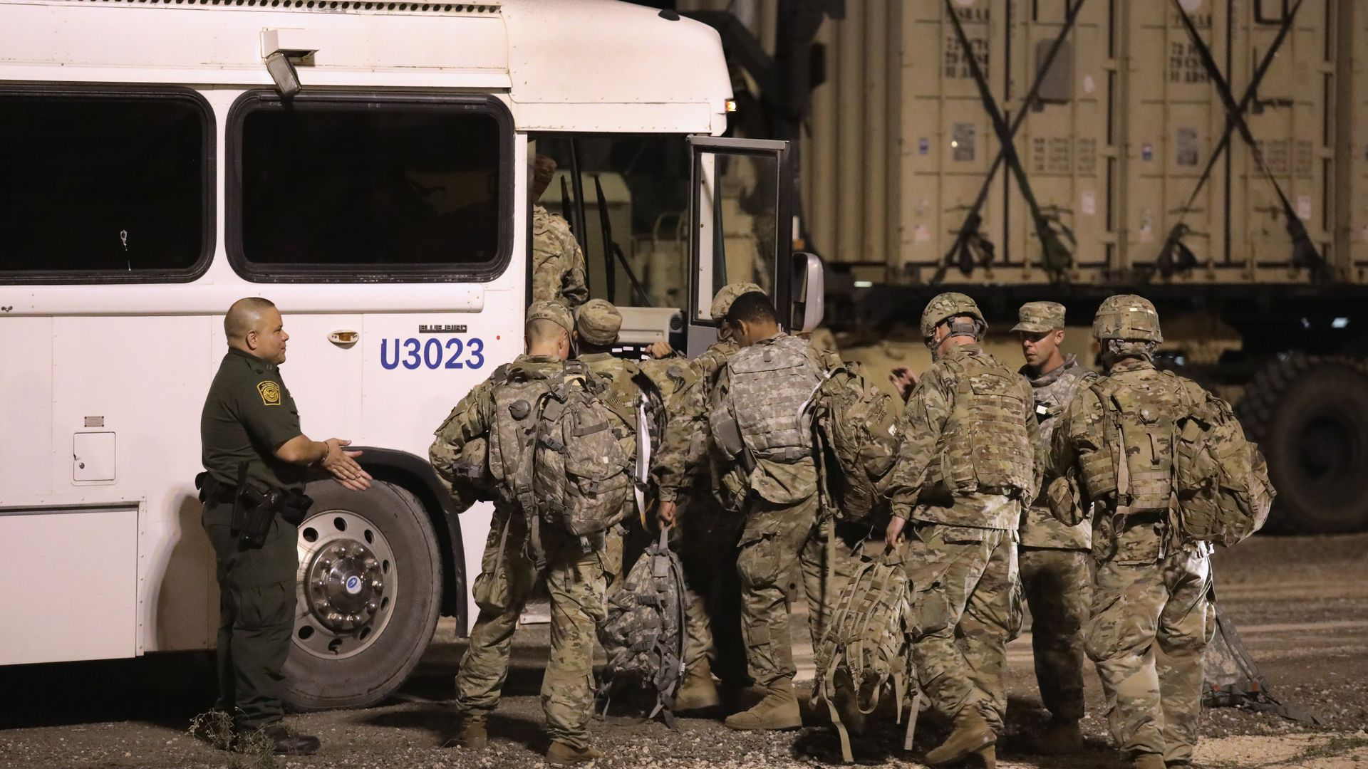 Troops at the border getting into a bus