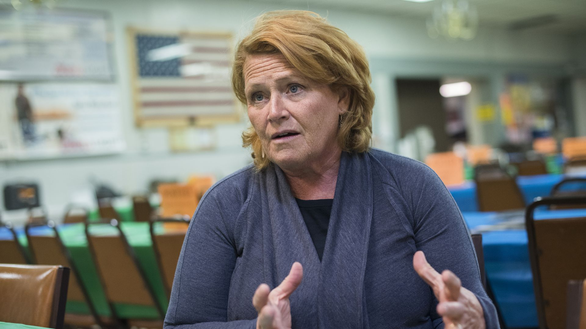 Heidi Heitkamp looks upset and gestures.
