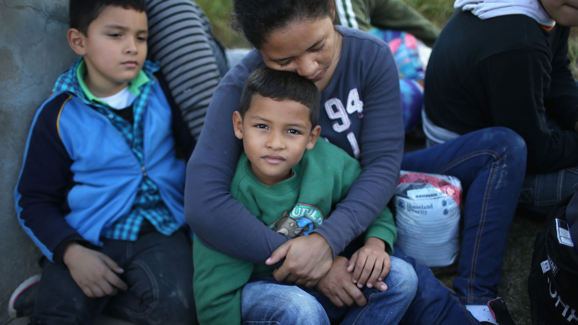 A Honduran mother holds her son, 7, after she turned her family in to U.S. Border Patrol agents on December 8, 2015 near Rio Grande City, Texas.