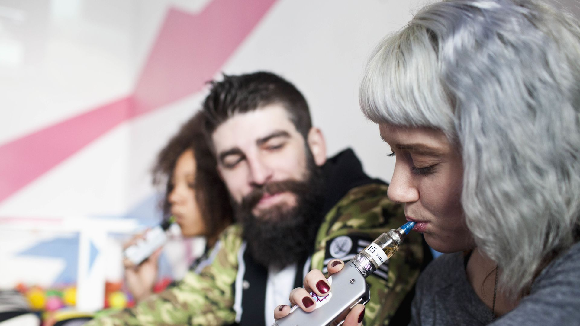 Young people vaping.