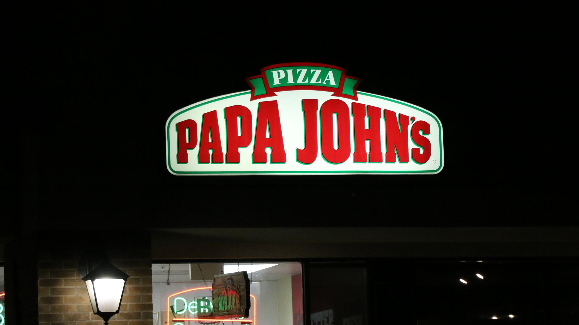 Neon sign of Papa John's pizza
