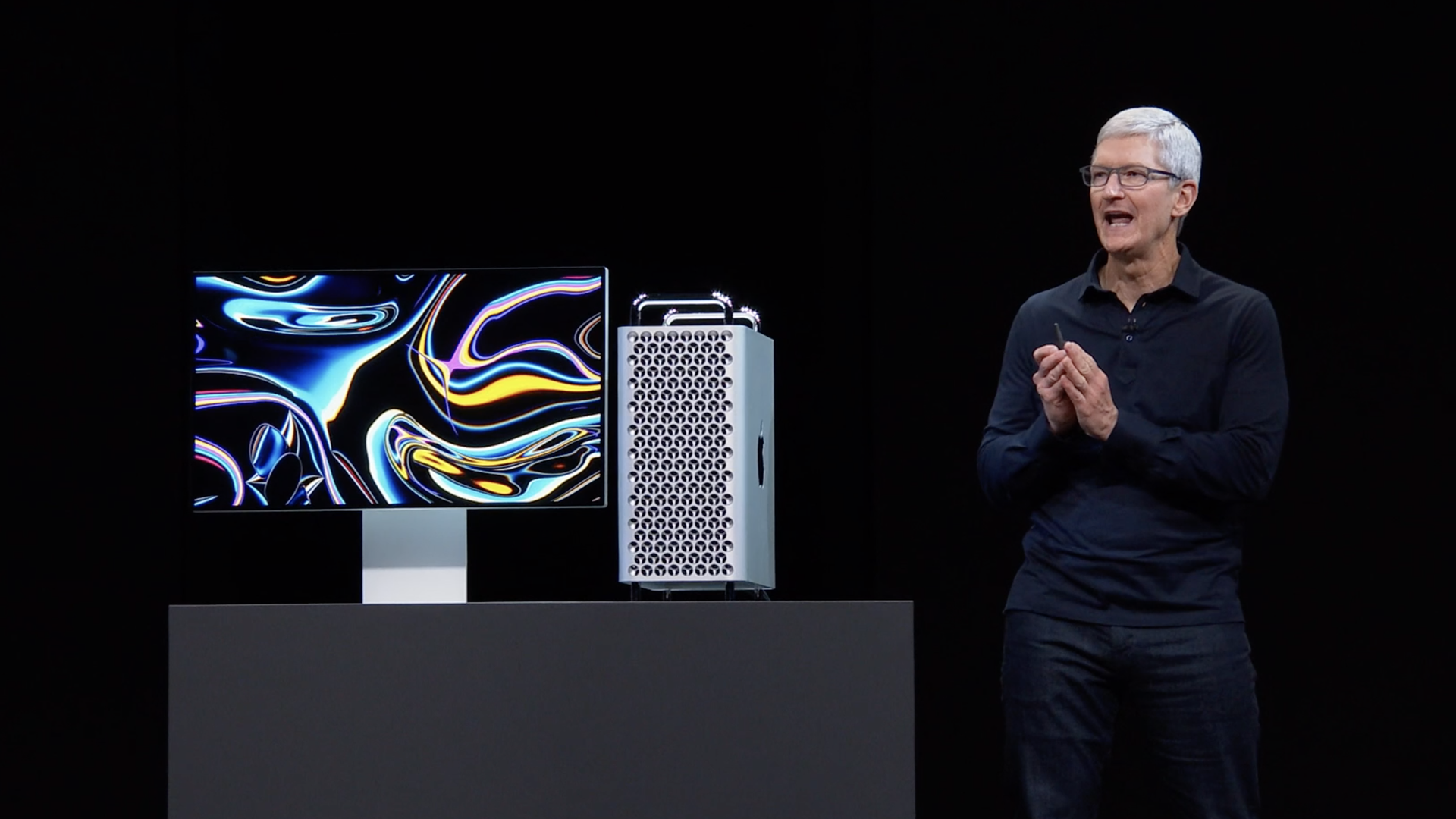 Apple CEO Tim Cook standing next to new model Mac Pro