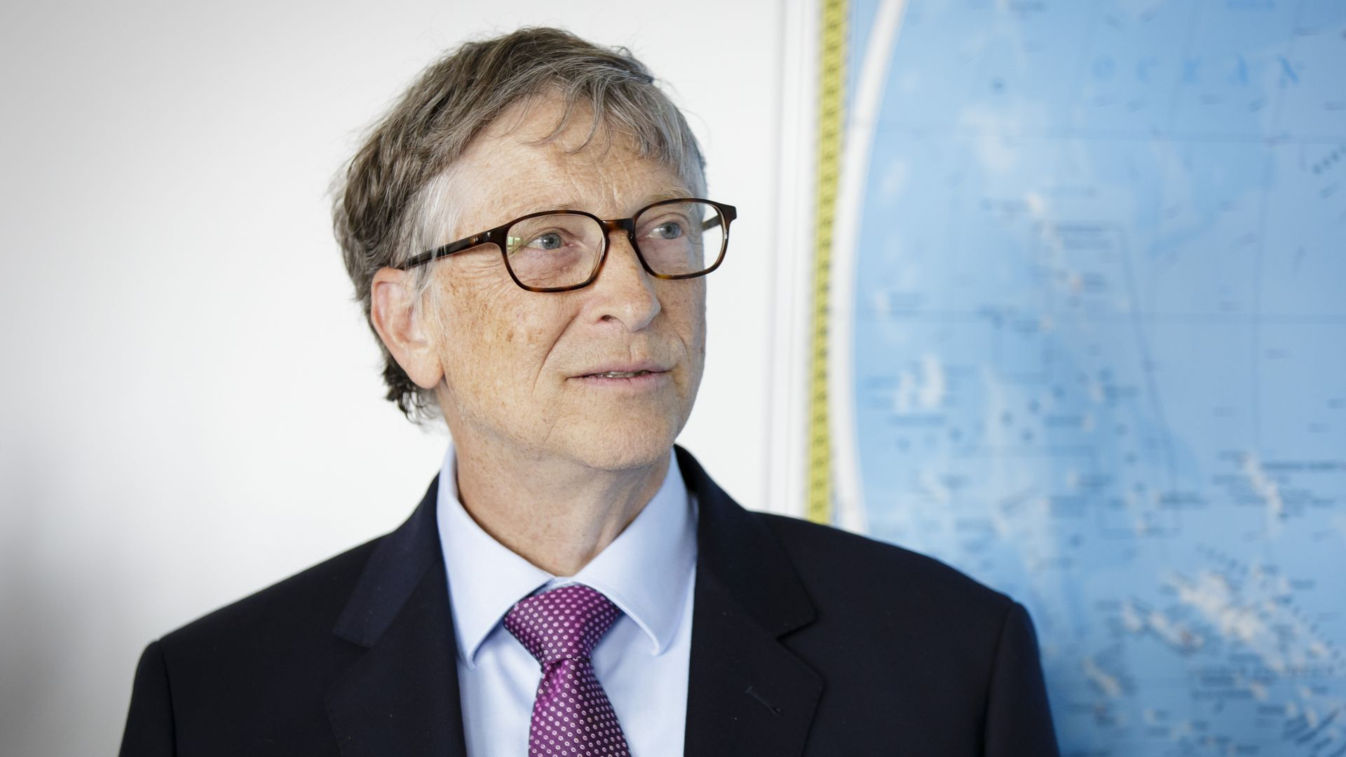 Bill Gates in front of map