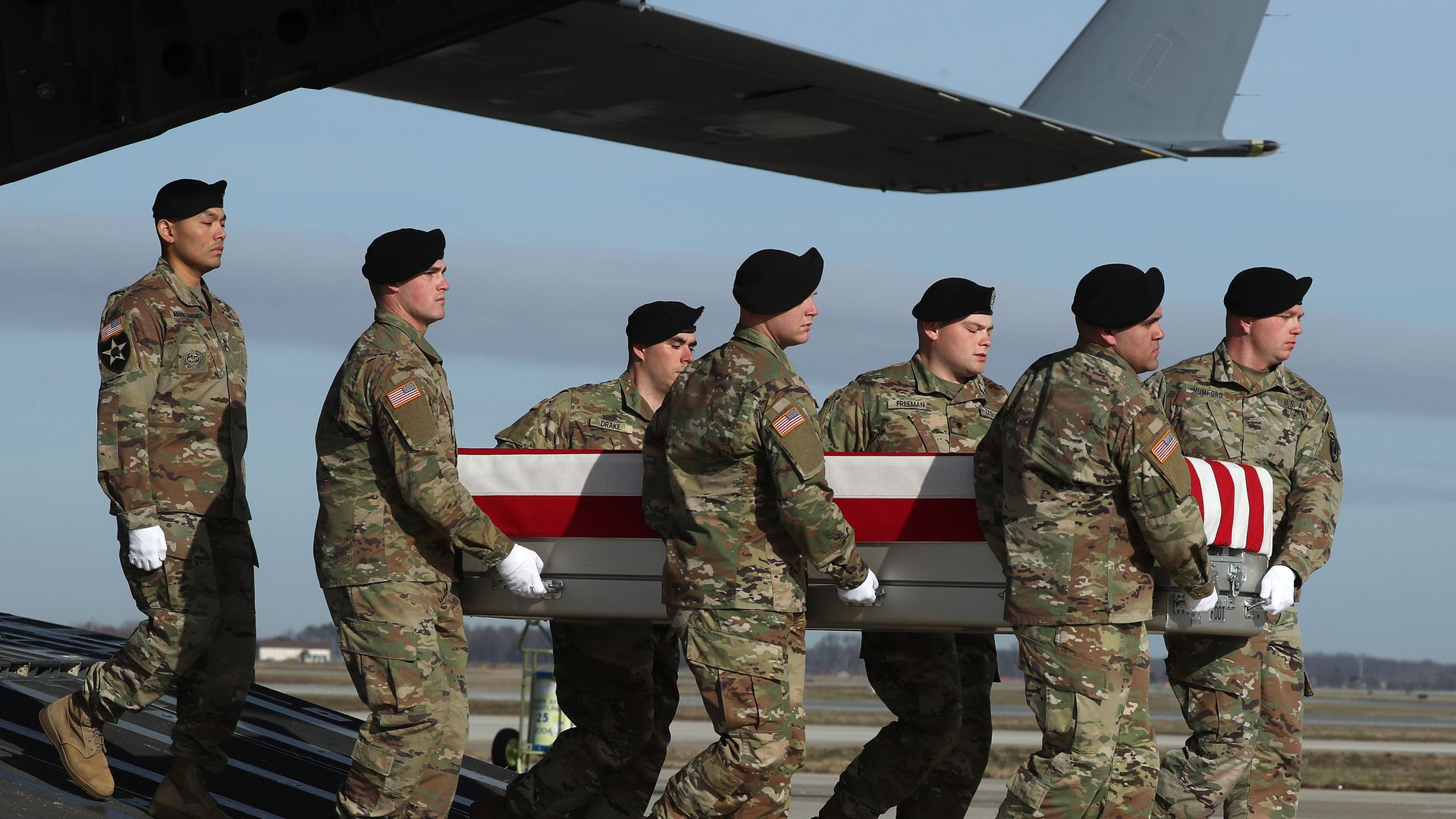 U.S. Army carry team moves the transfer case containing remains of U.S. Army Sgt. 1st Class Michael Goble.