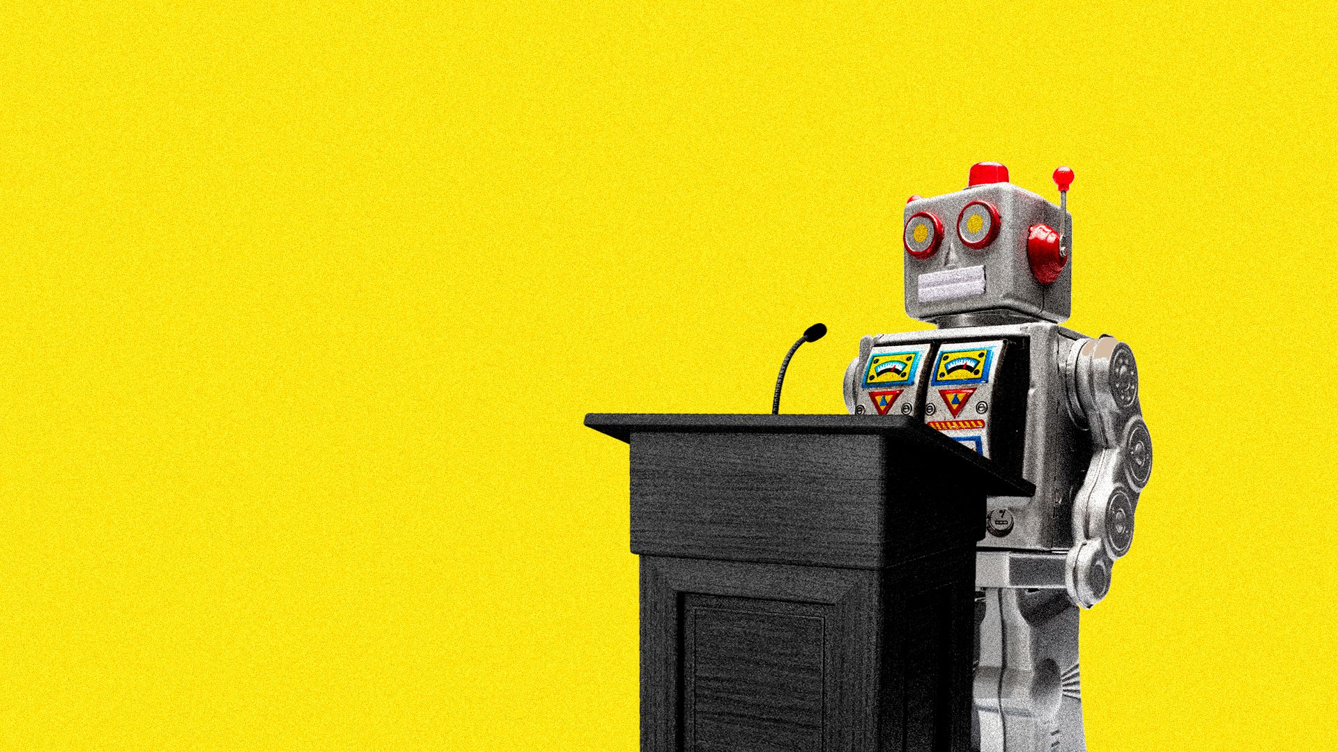 A robot stands behind a podium
