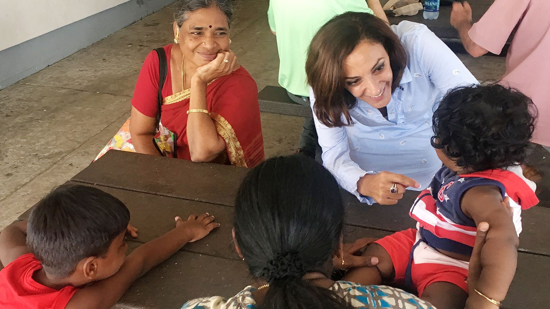 Katie Arrington chats with children and a mother in South Carolina
