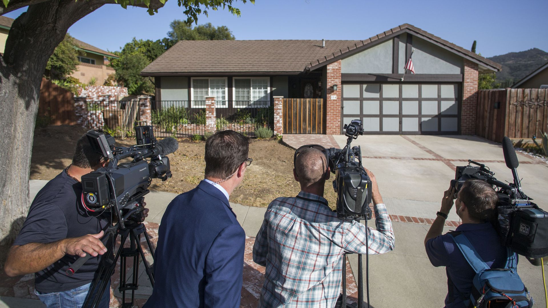 Media crowds outside of suspected California shooter's home.