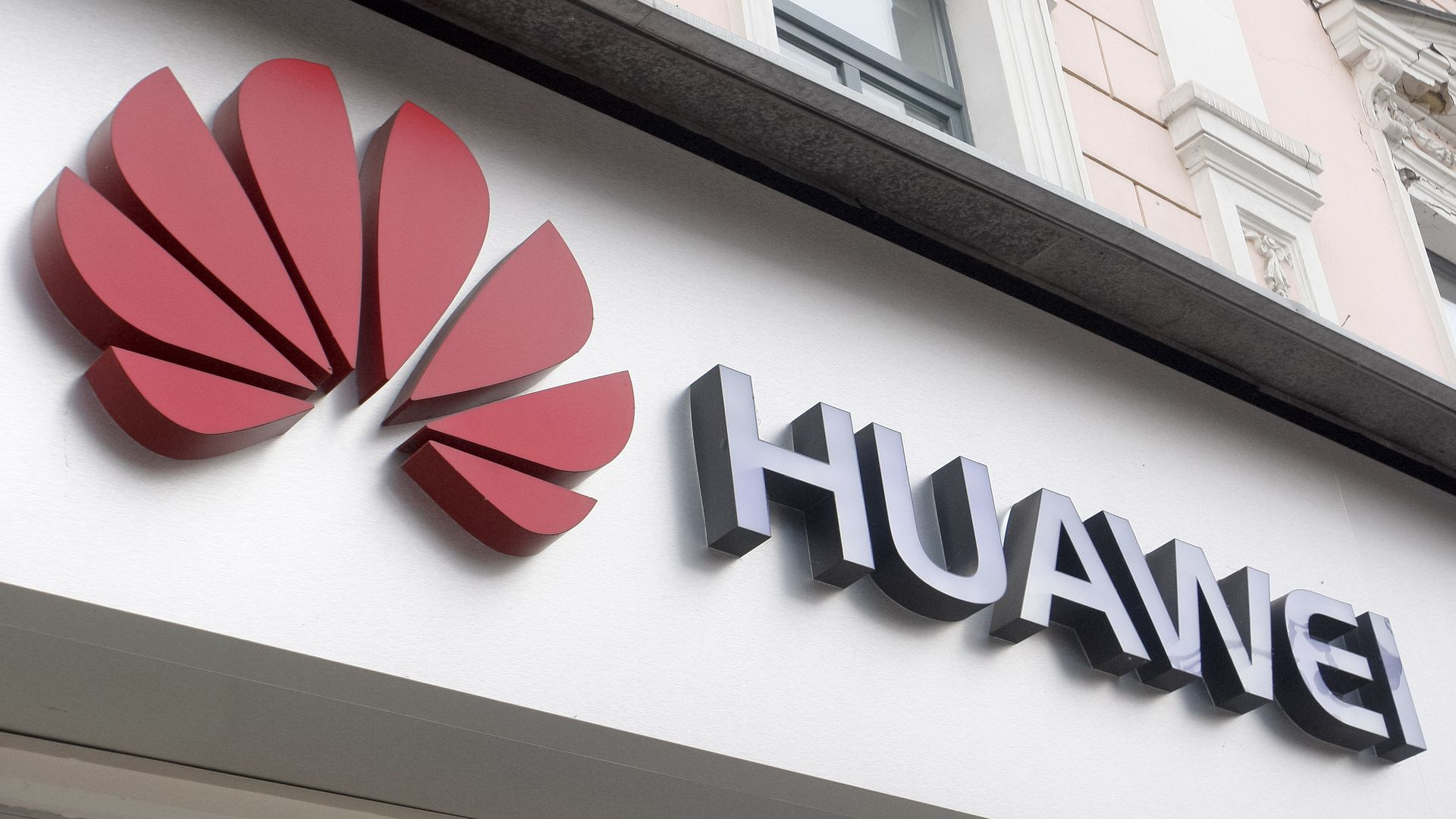 The Huawei logo affixed to a buiding.