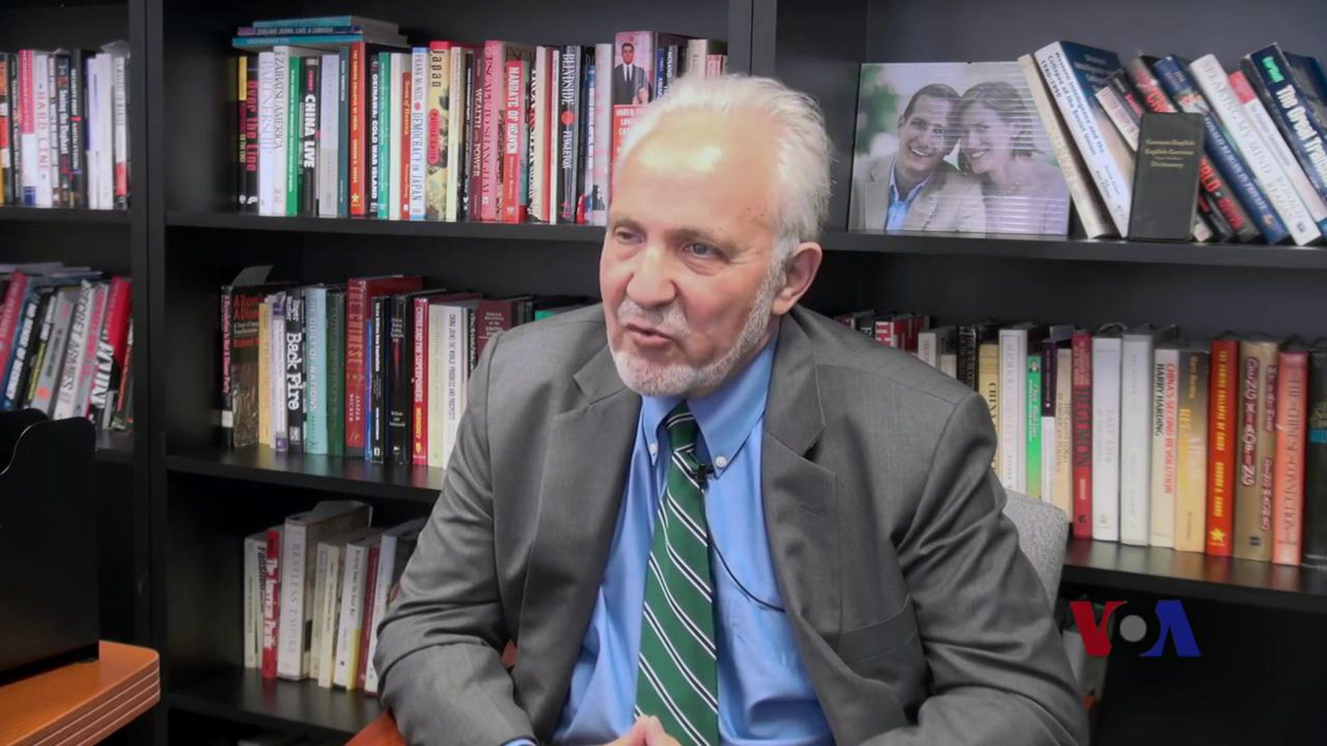 Photo of author James Mann in his office during interview with VOA