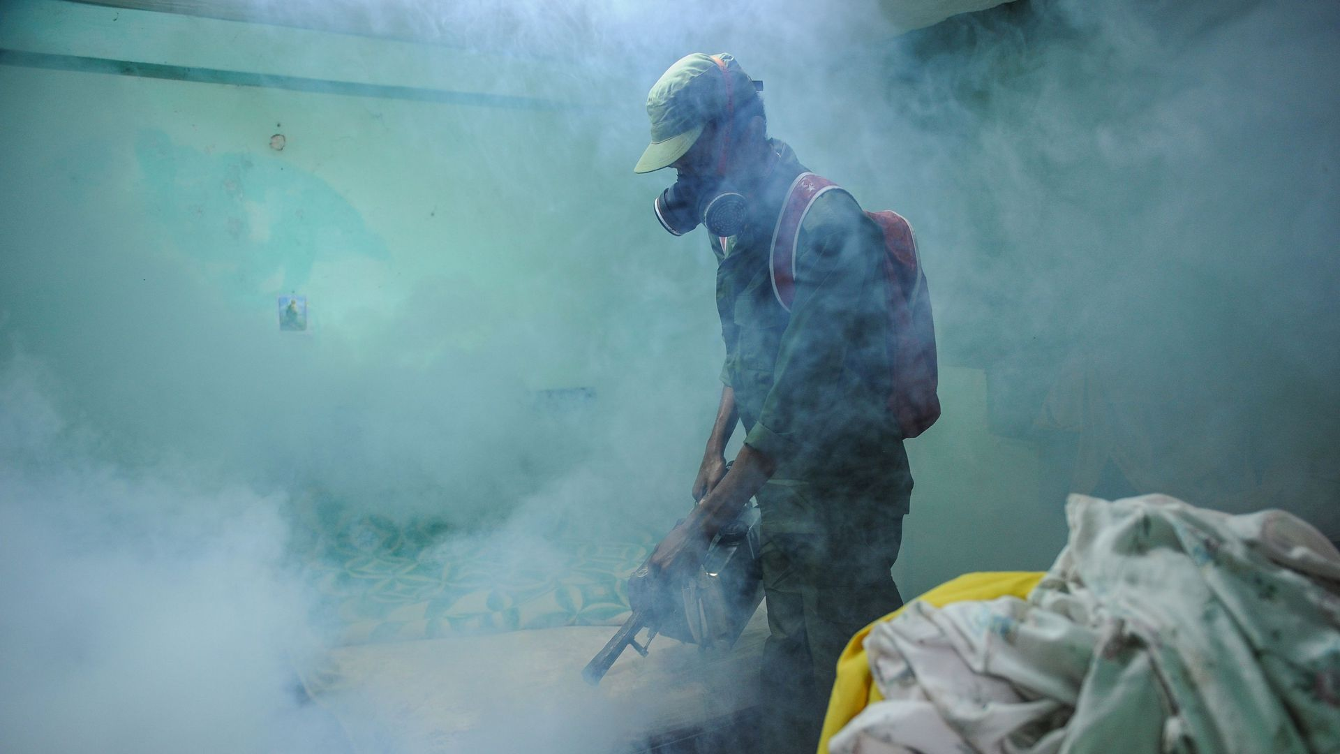 Member of the Cuban army fumigates against mosquitoes following Zika outbreak