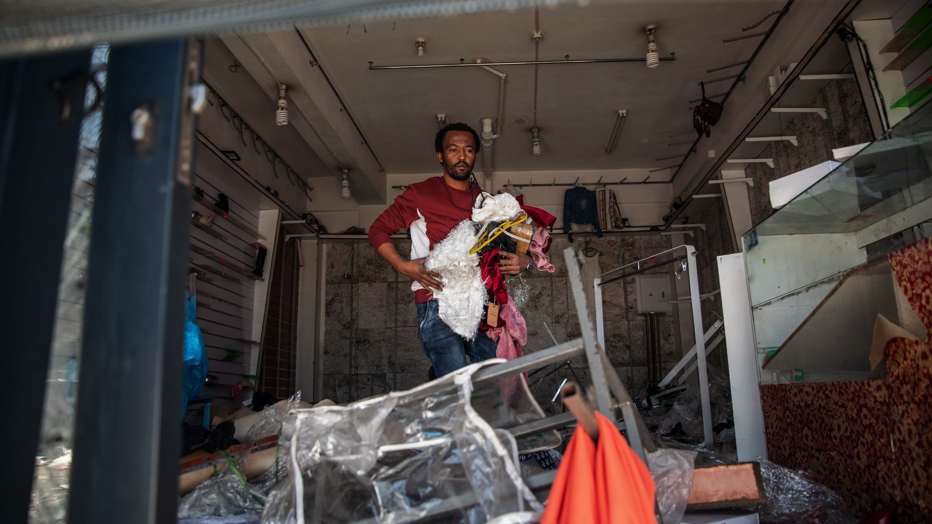 A foreign shop owner checks the damages to his looted shop in Johannesburg, South Africa, on Tueaday.