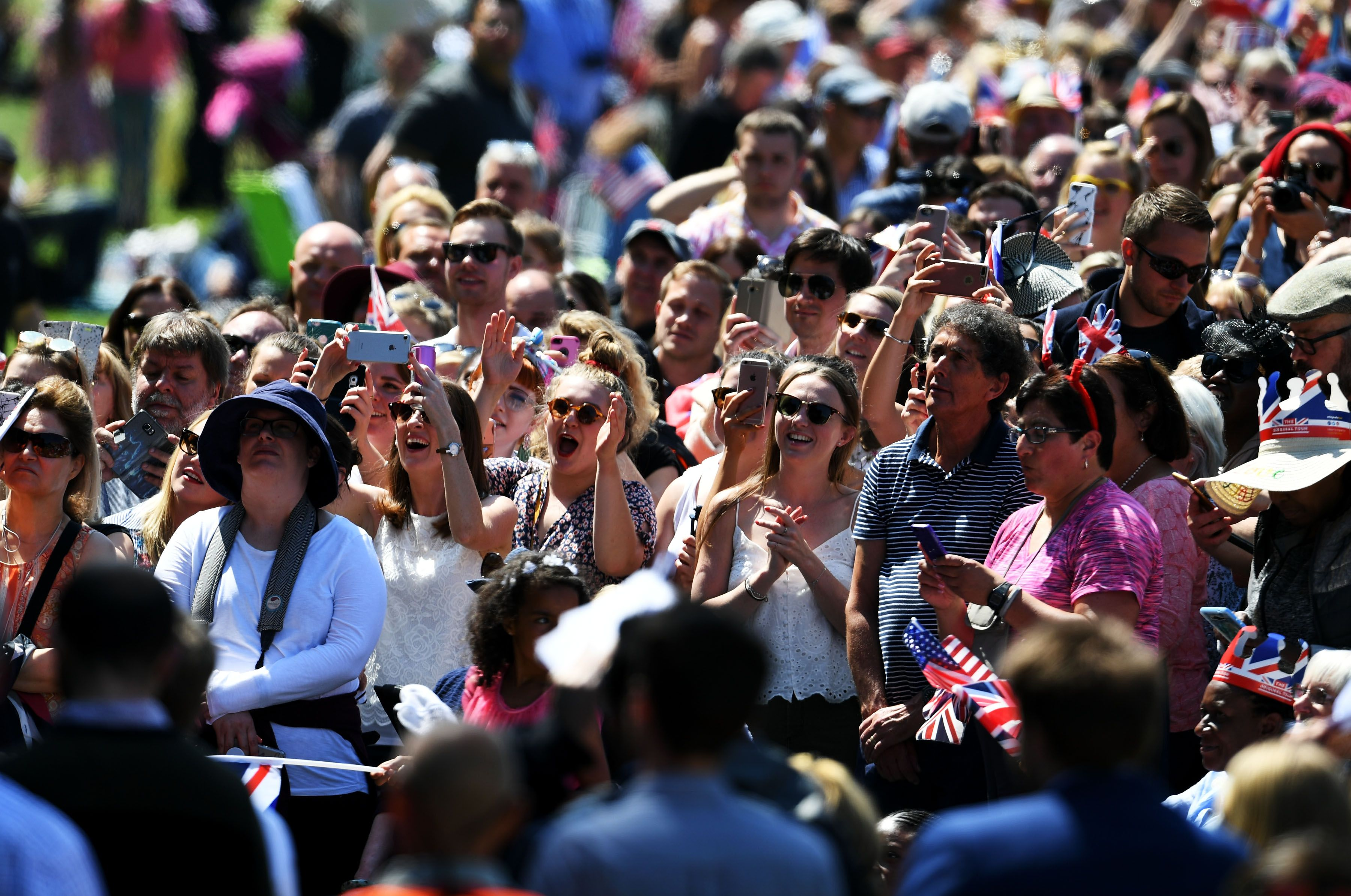 The crowd reacts as Ms. Meghan Markle's car makes it's way down The Long Walk