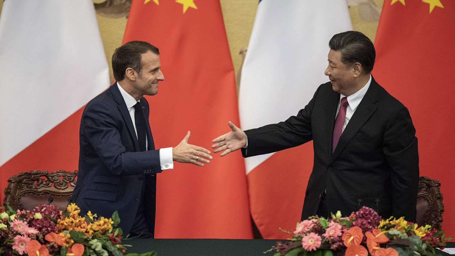 French President Macron shakes hands with Chinese President Xi