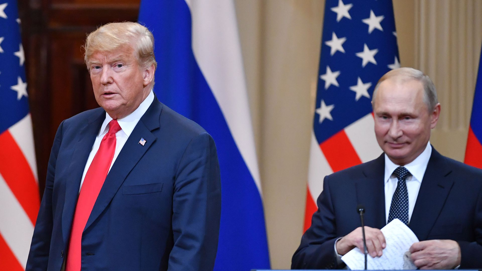 US President Donald Trump (L) and Russia's President Vladimir Putin arrive to attend a joint press conference after a meeting at the Presidential Palace in Helsinki, on July 16, 2018.