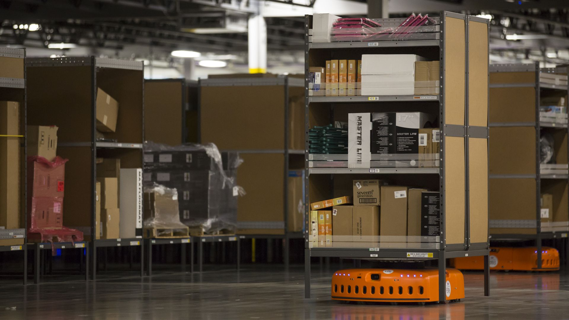 An Amazon Kiva robot, which helps fill orders by bringing shelves of merchandise to Amazon Associates
