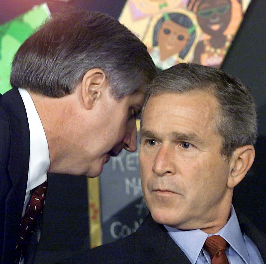 Former President George W. Buck listens as his chief of staff delivers news on Sept. 11, 2001.