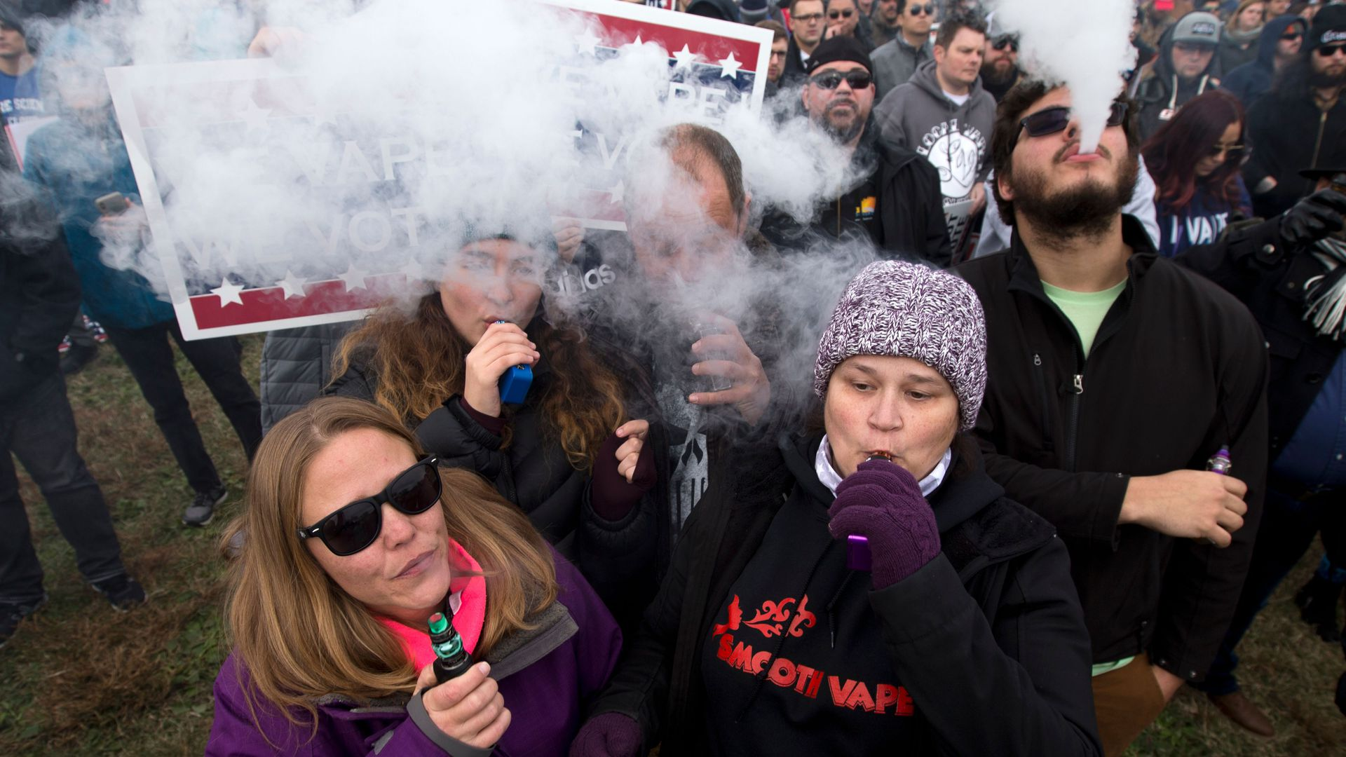 Demonstrators vape during a consumer advocate groups and vape storeowners rally outside of the White House to protest the proposed vaping flavor ban in Washington DC on November 9, 2019.