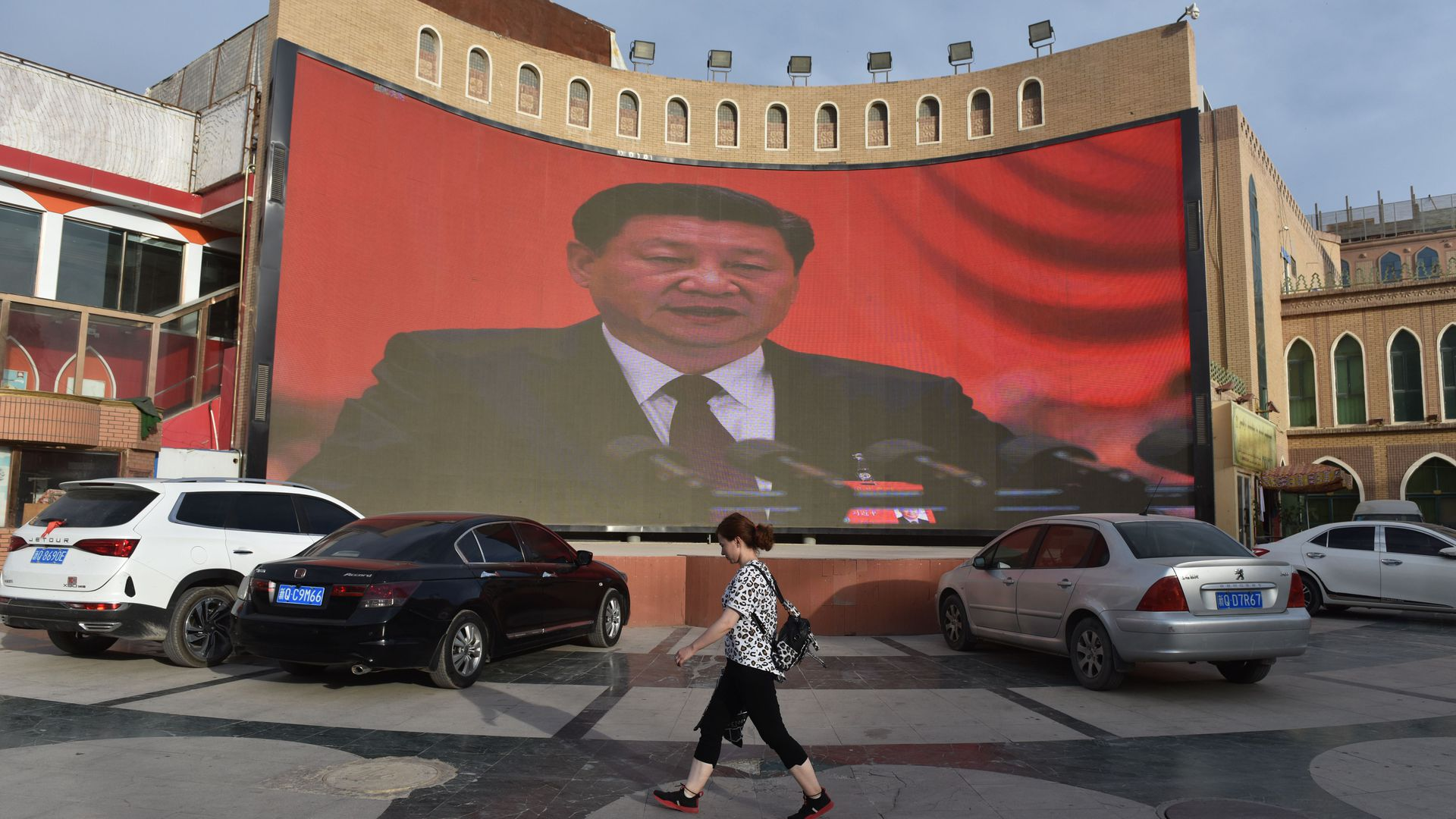 A screen showing images of Chinese President Xi Jinping in Xinjiang