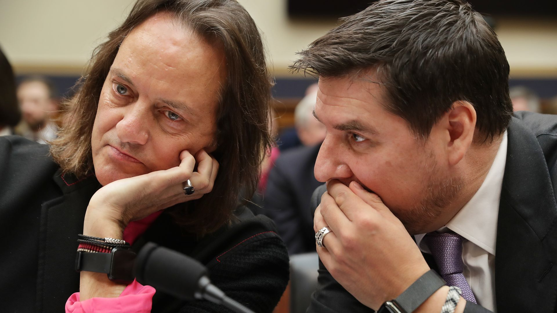 T-Mobile CEO John Legere and Executive Director of Sprint Marcelo Claure talk before testifying to the House Judiciary Committee