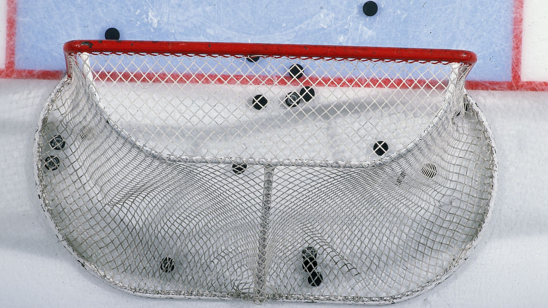 hockey goal with pucks in it