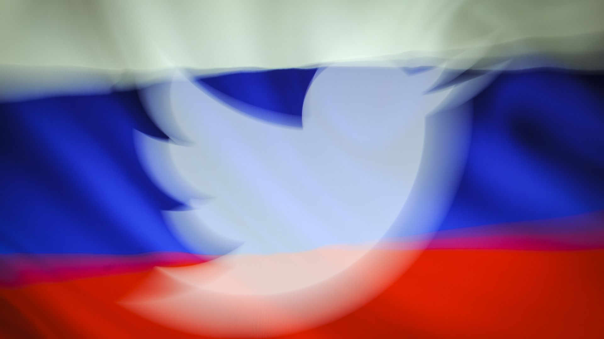 Twitter logo in front of Russian flag