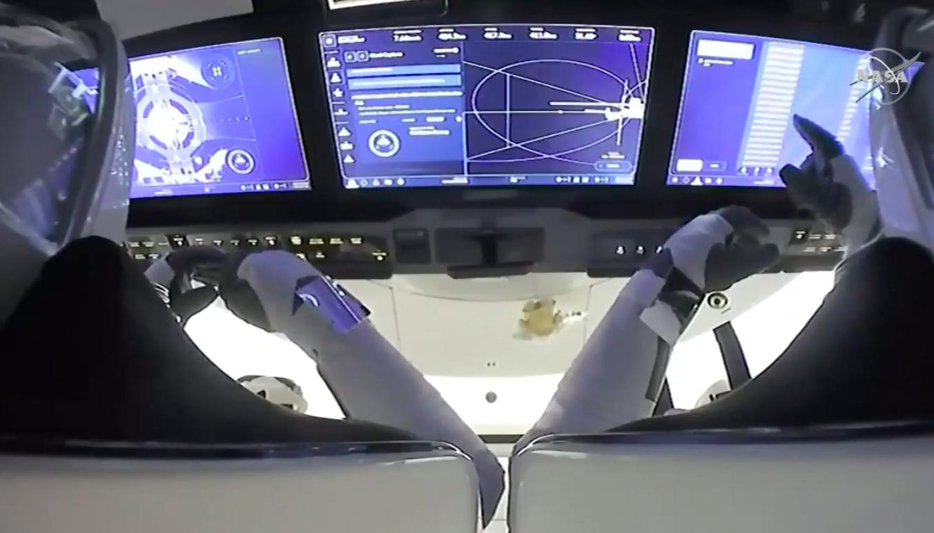 Crewed SpaceX capsule docks to International Space Station
