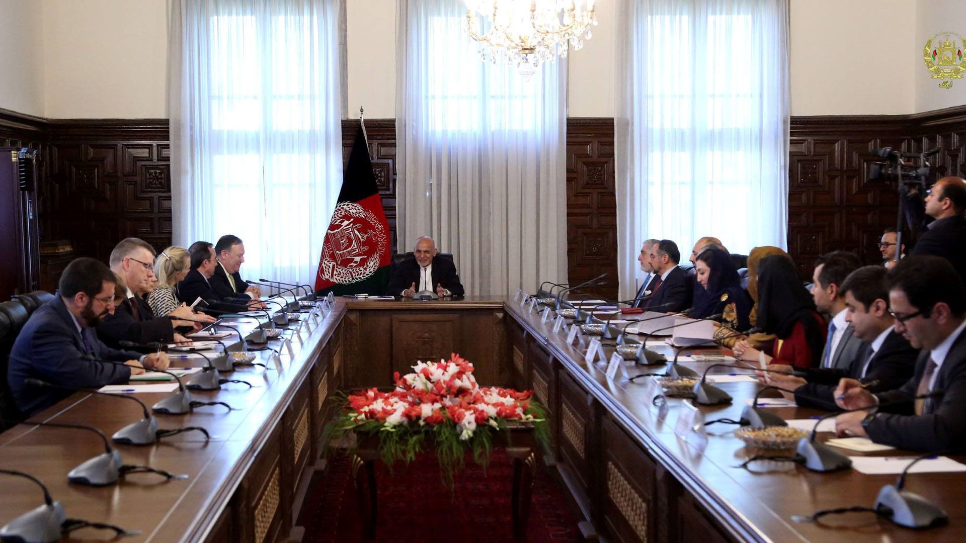 A large table with U.S. and Afghanistan representatives, with President Ashraf Ghani at the head.
