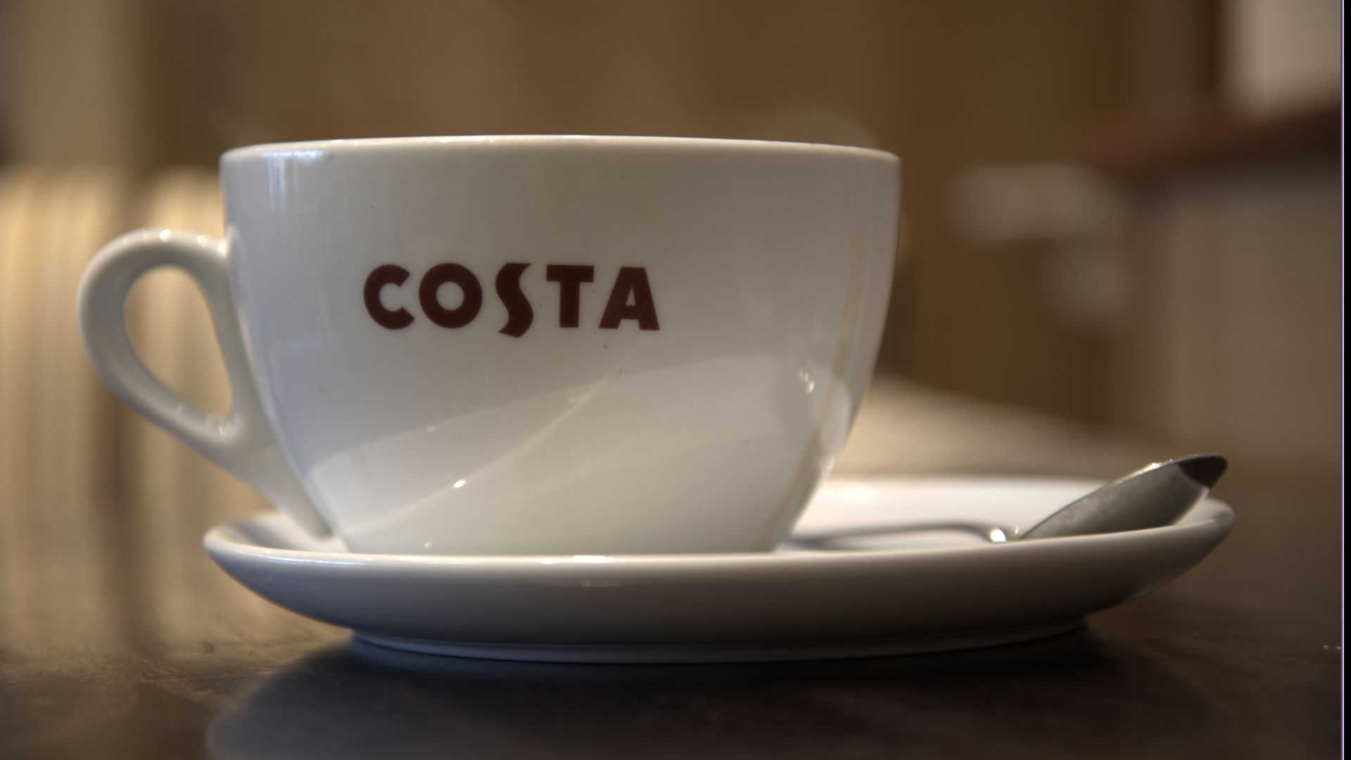 A Costa coffee cup.