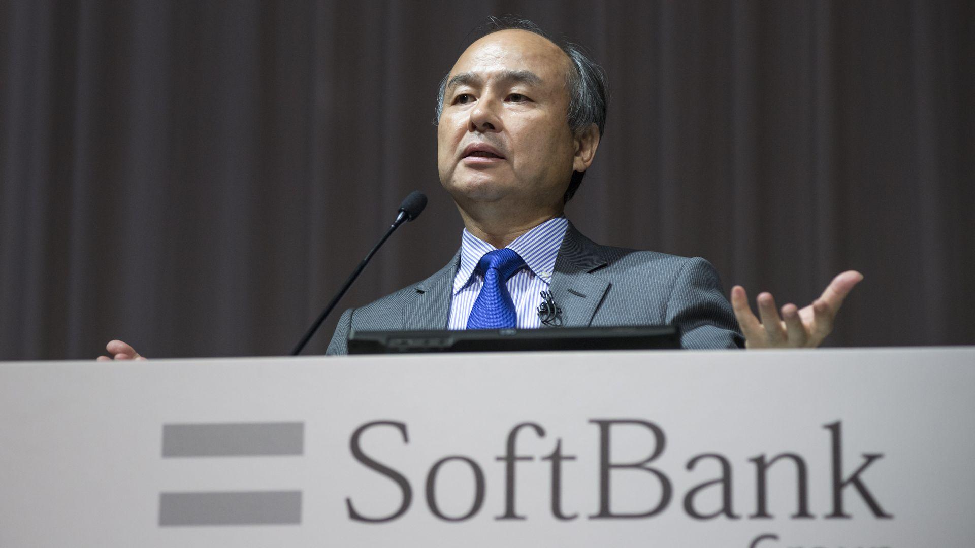 Photo of SoftBank CEO Masayoshi Son at quarterly earnings presentation.