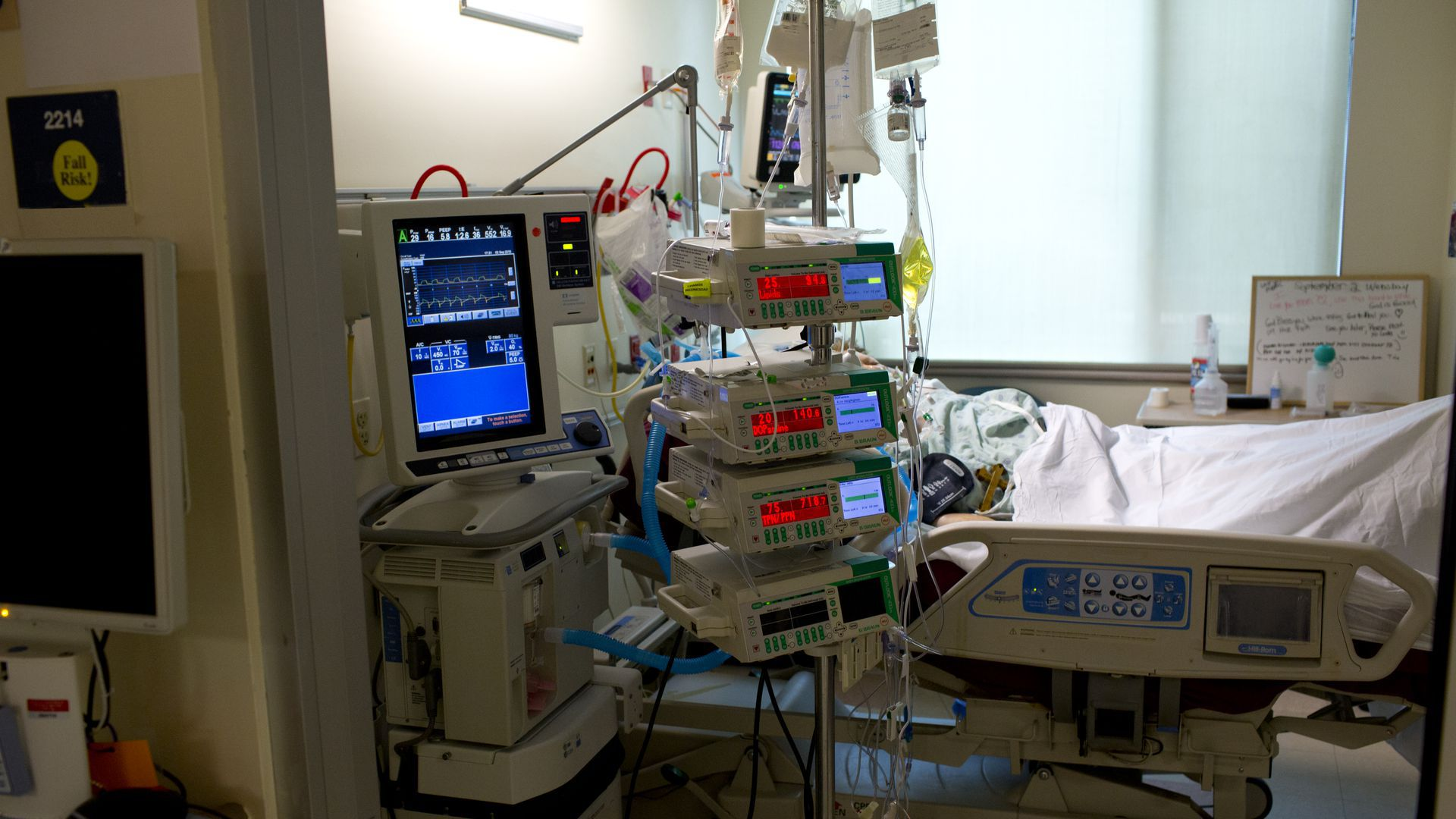 Hospital bed with machines next to it