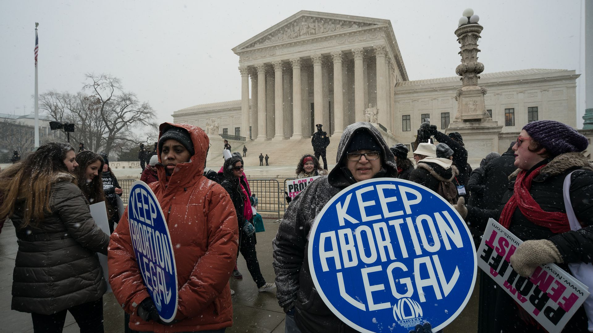 "Protesters wave a ""Keep Abortion Legal"" sign outside the Supreme Court"