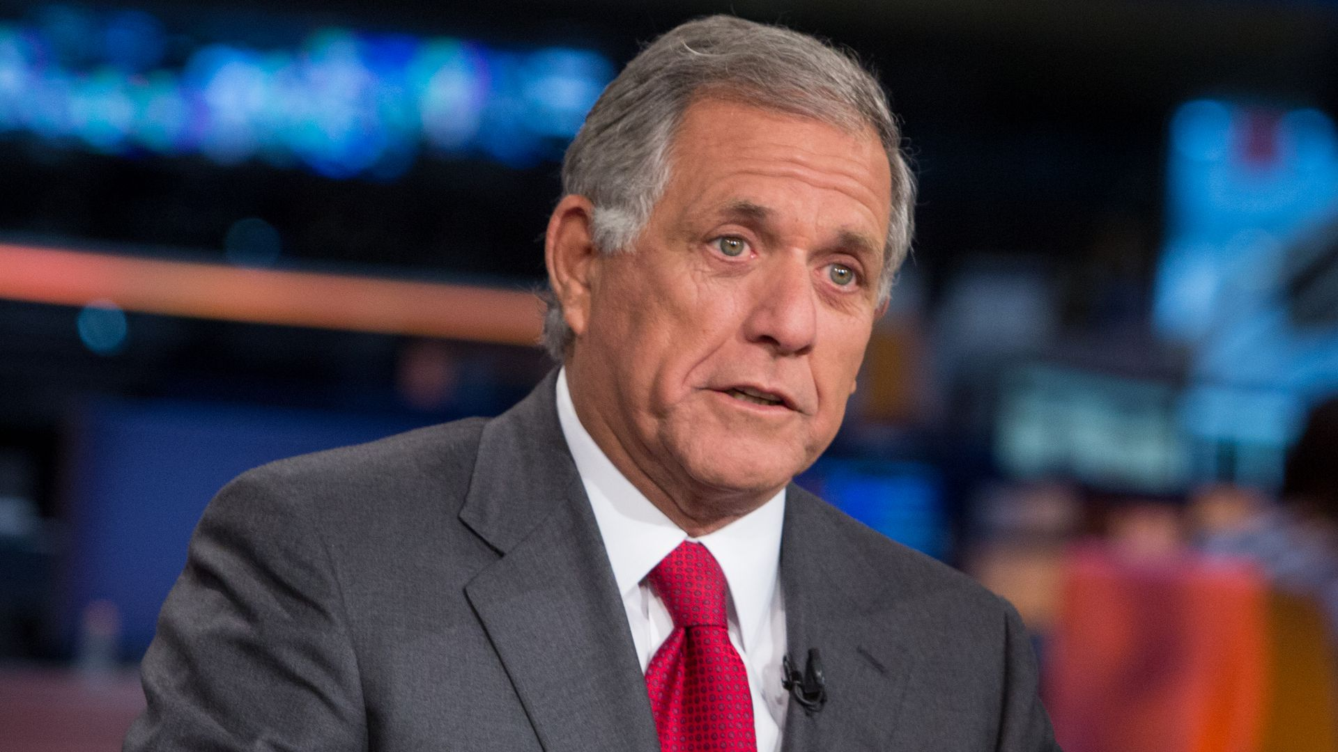 LEs Moonves wearing a gray suit and red tie.