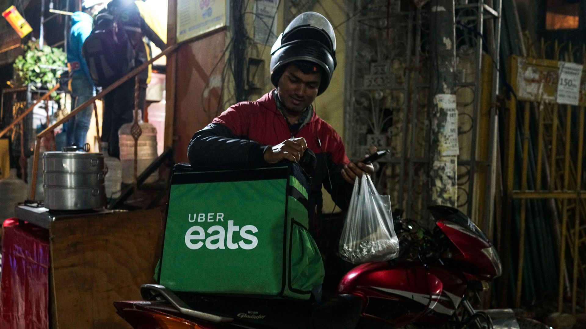 Zomato buys Uber's food delivery business in India for $350 million