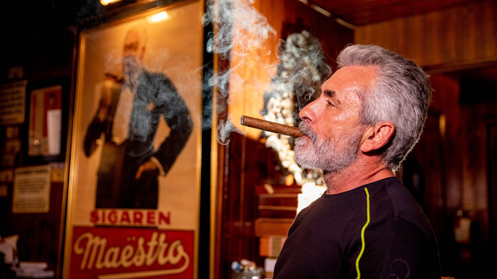 Rigo Fernandez, owner of Buena Vista Cigar Club, smokes a cigar in his lounge in Beverly Hills, California, May 21, 2019.