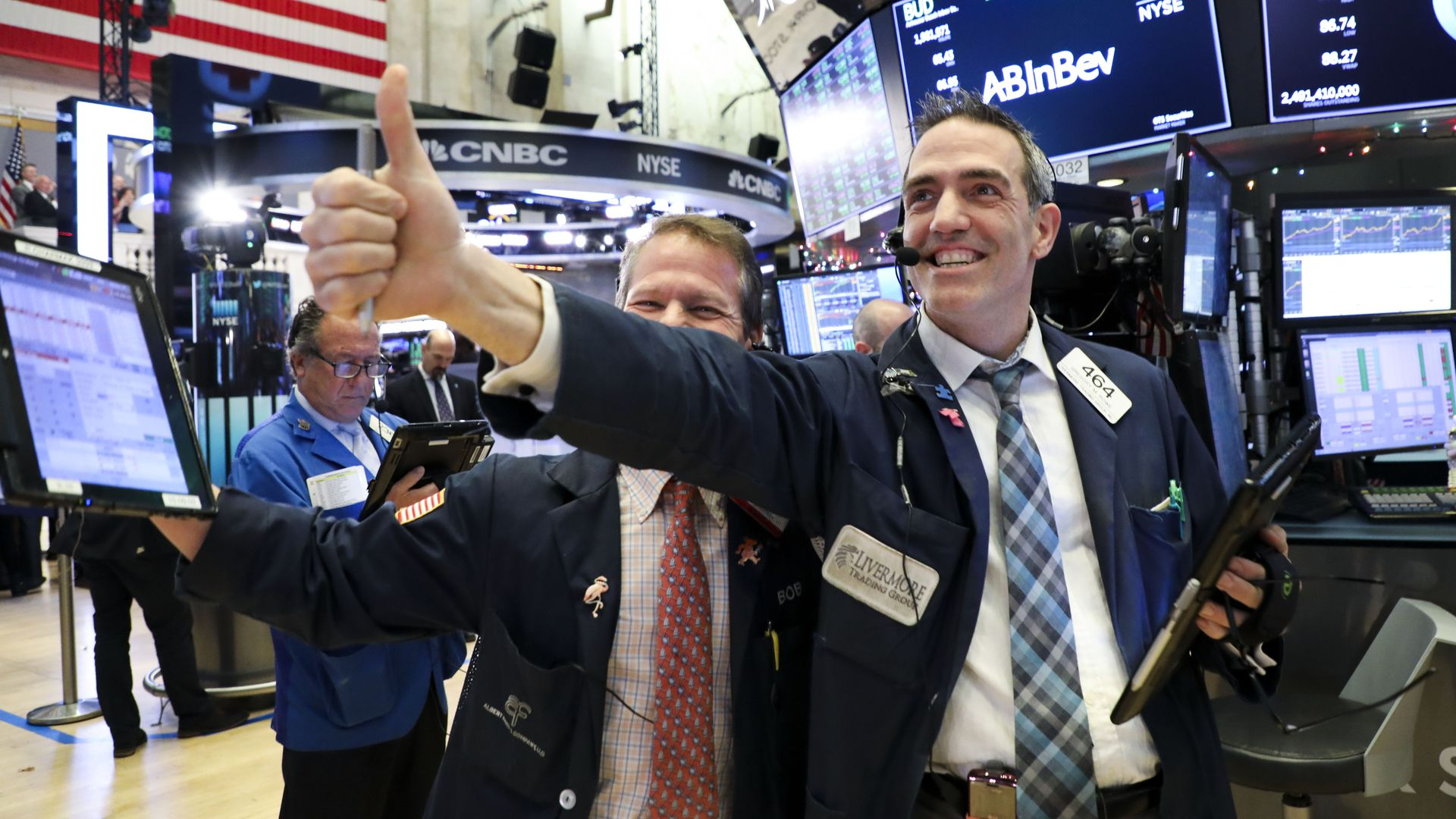 Traders work at the NYSE in New York