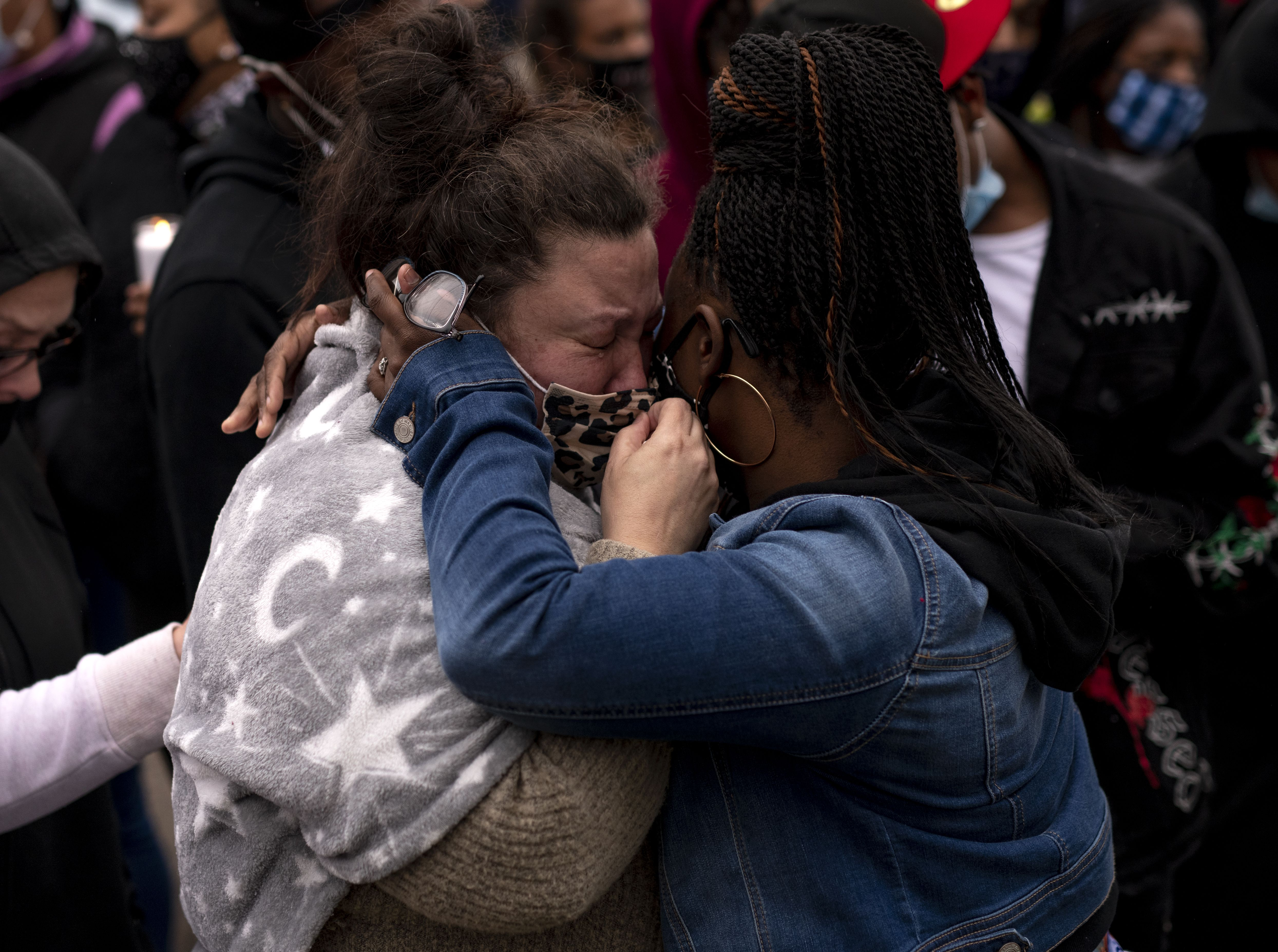 Katie Wright (L), the mother of Daunte Wright, is embraced during a vigil for her son on April 12, 2021 in Brooklyn Center, Minnesota.