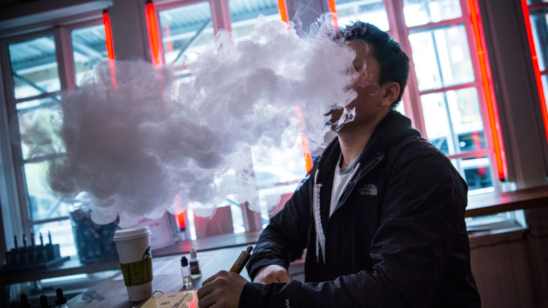 Man vaping in a coffee shop