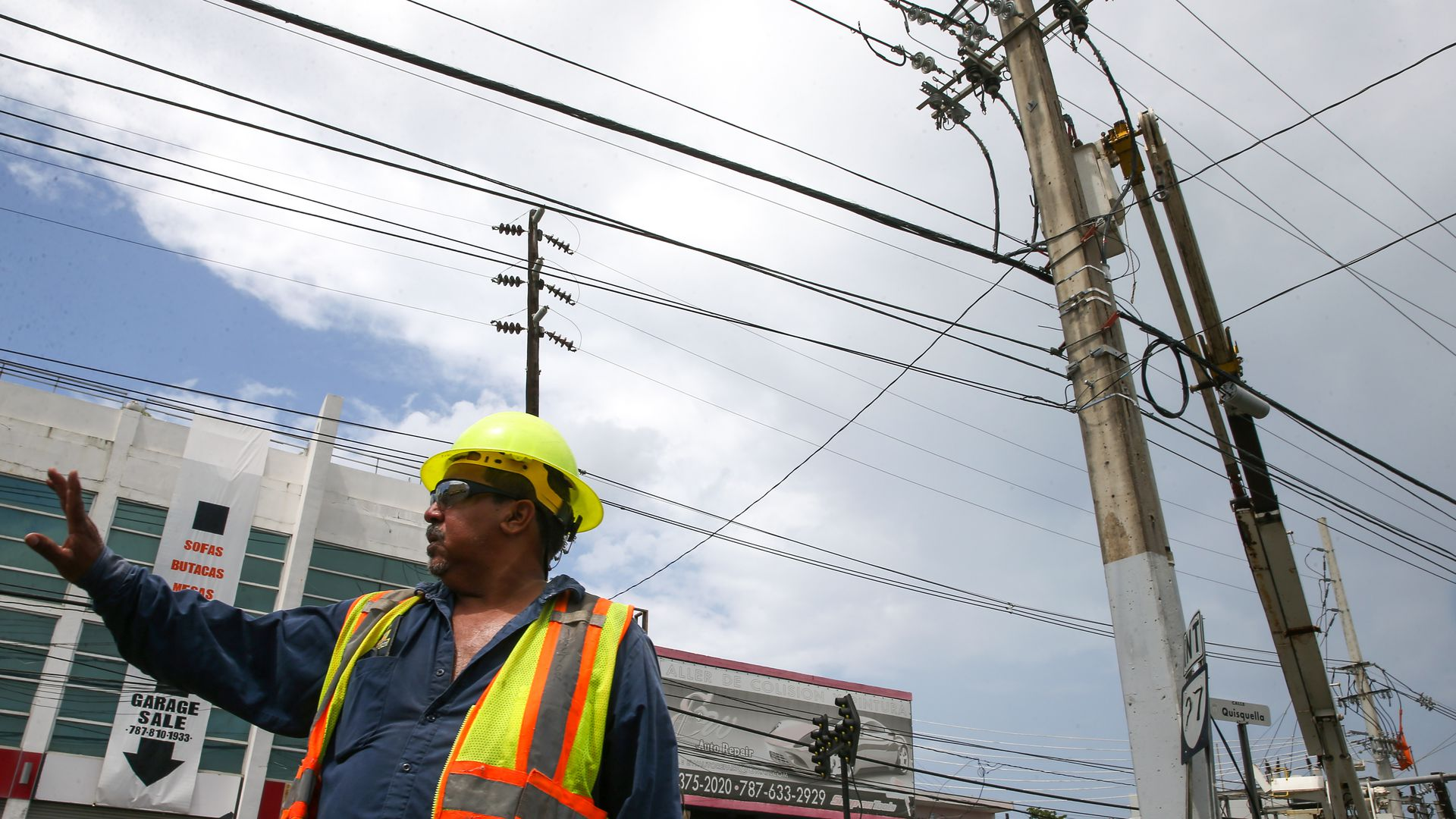 Puerto Rico's workers working on power lines