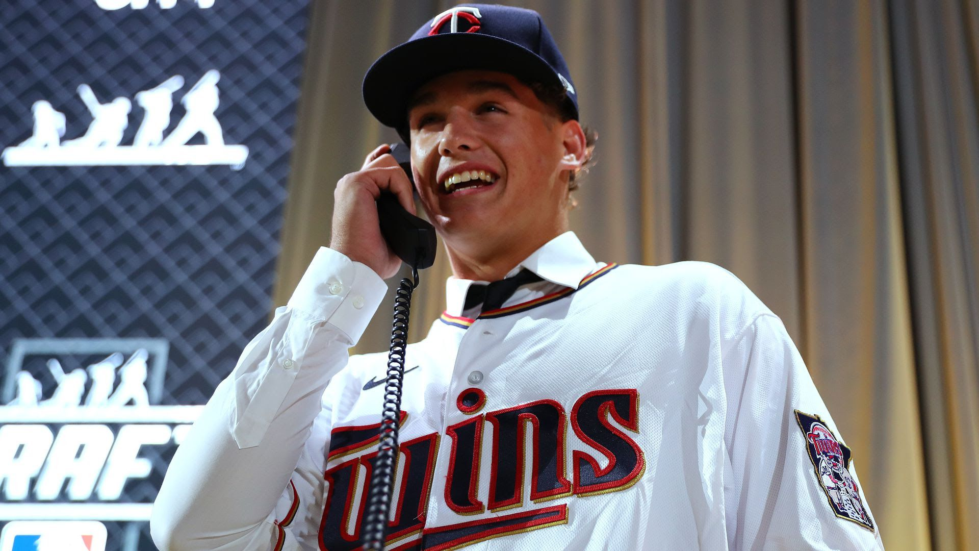 Minnesota Twins first-round pick Chase Petty smiles while answering the phone on MLB Draft night.