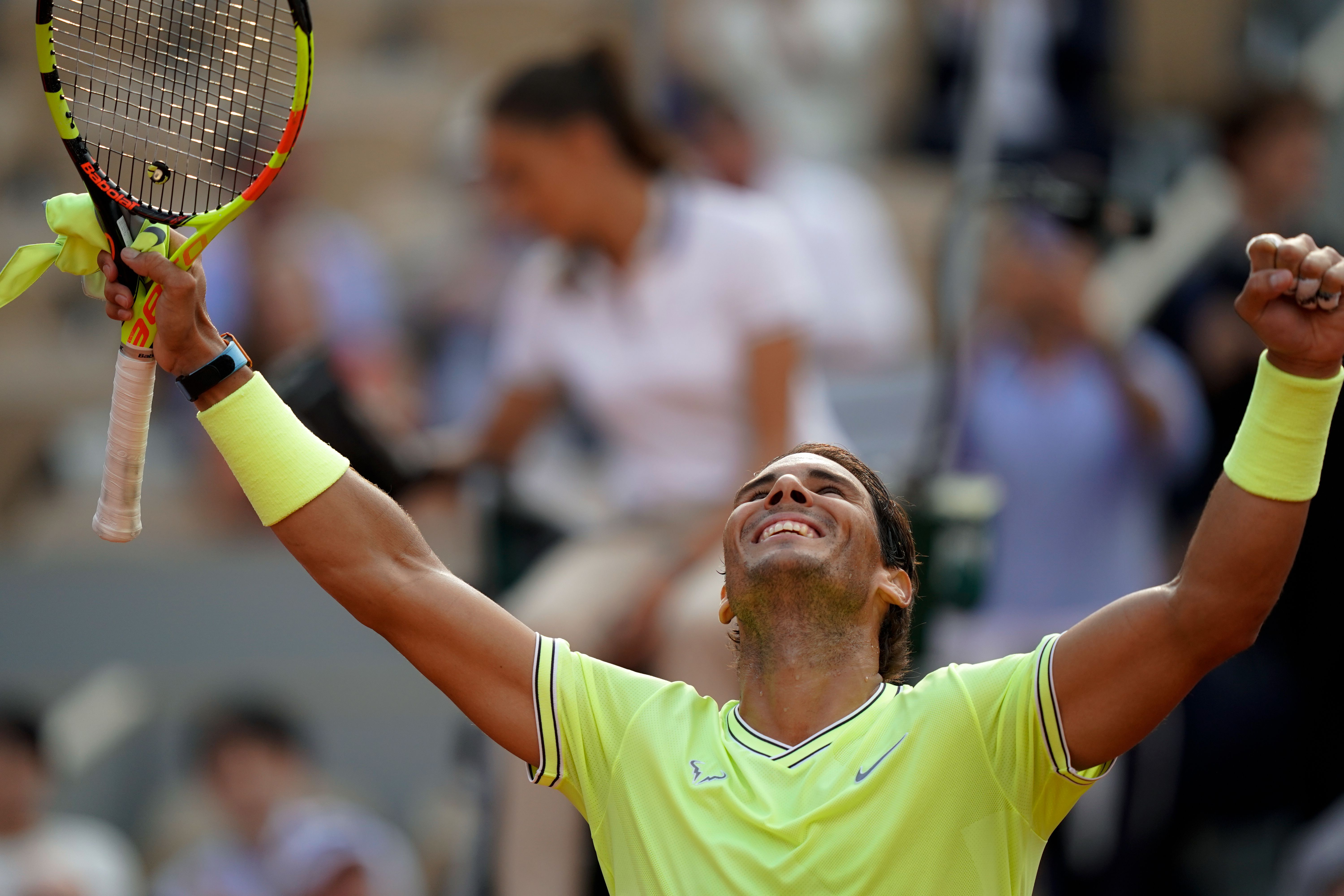 Rafael Nadal with his arms raised in the air