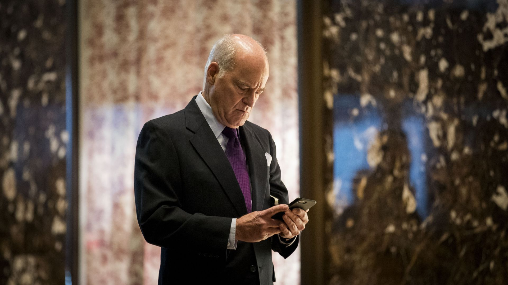 KKR co-founder Henry Kravis, looks at phone while at Trump Tower.