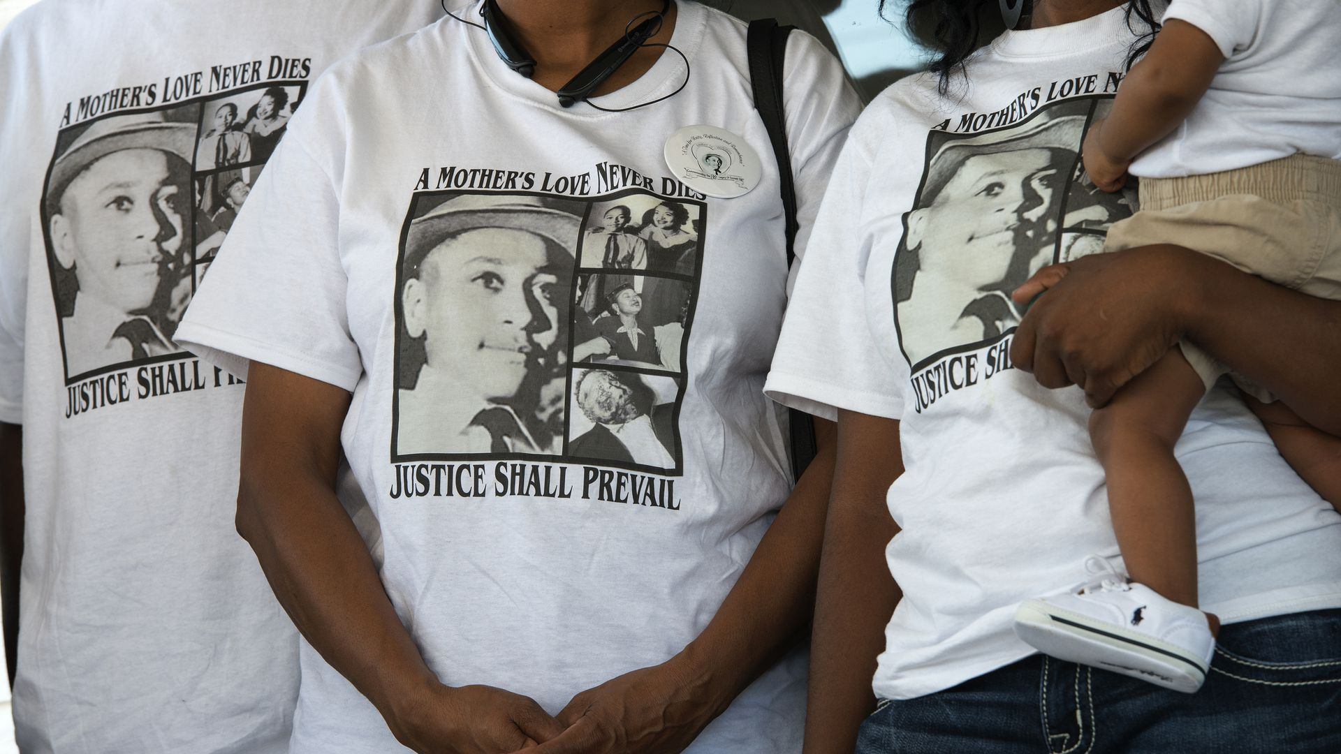 Descendants of Emmett Hill wearing t-shirts with images of Till on them